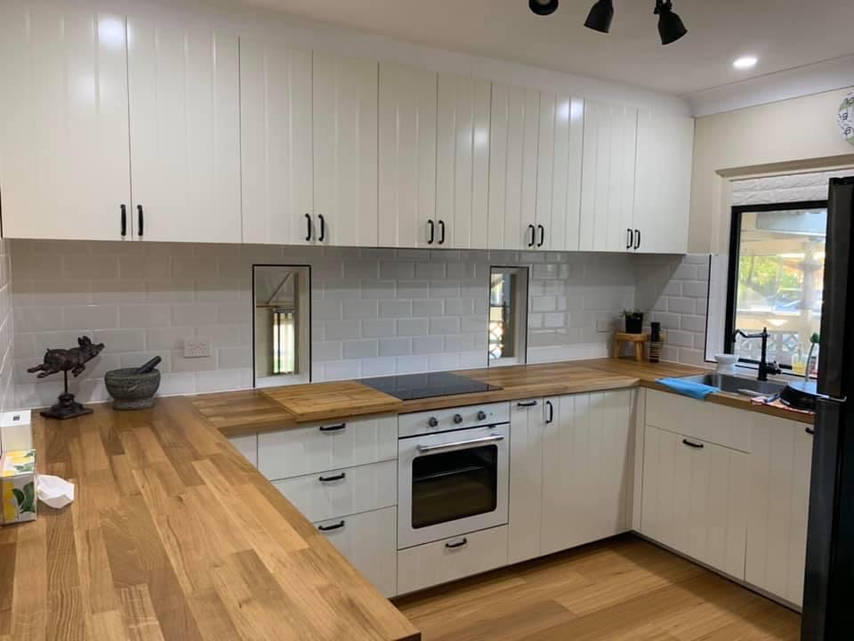 flatpack white kitchen with grooved doors