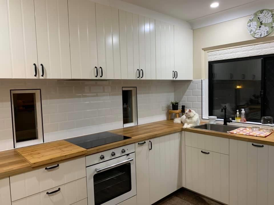 white flat pack kitchen with timber bench
