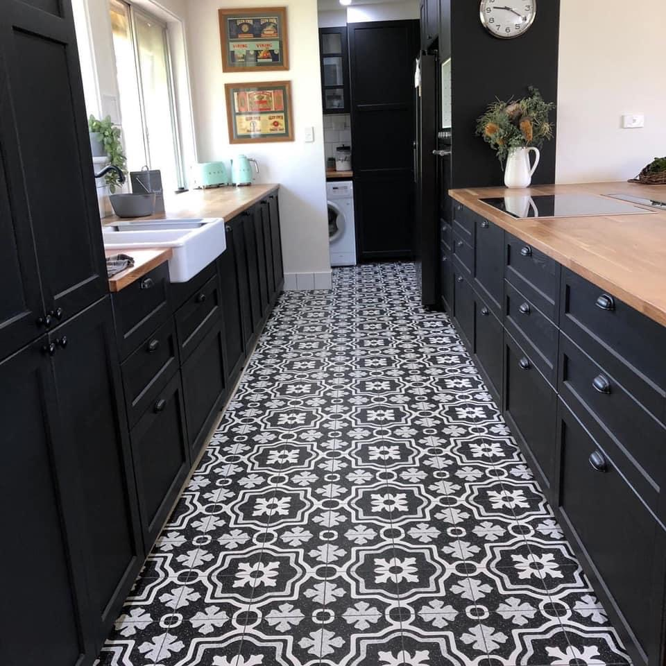 black kitchen with feature tiles